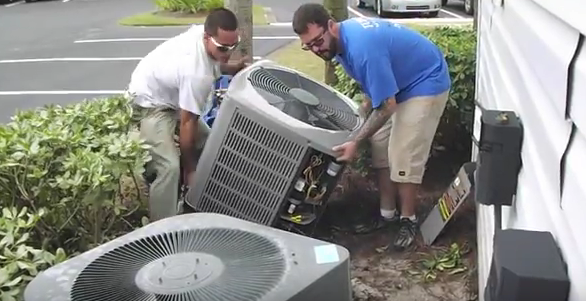 2 Men Moving Ac Unit